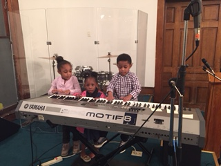 Some of kids in the church exploring their musical talents after service